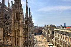 HDR photo of the white marble statues of Cathedral Duomo di Milano on piazza, Milan cityscape and Galleria Vittorio Emanuele II Stock Image