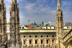 HDR photo of the white marble statues of Cathedral Duomo di Milano on piazza, Milan cityscape Royalty Free Stock Photography