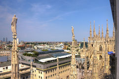 HDR photo of white marble statues of Cathedral Duomo di Milano on piazza, Milan cityscape Stock Images
