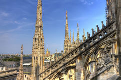 HDR photo of the white marble statues and decorations on the Cathedral Duomo di Milano on piazza in Milan Royalty Free Stock Photos