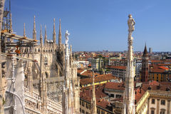 HDR photo of the white marble statues and decorations on the Cathedral Duomo di Milano on piazza in Milan Royalty Free Stock Images