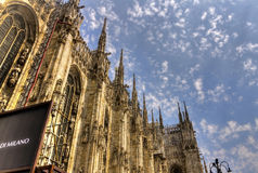 HDR photo of the white marble statues and decorations on the Cathedral Duomo di Milano on piazza in Milan Stock Photo
