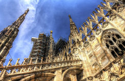 HDR photo of the white marble statues and decorations on the Cathedral Duomo di Milano on piazza in Milan Royalty Free Stock Photo