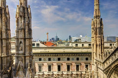 HDR photo of the white marble statues of Duomo and Milano cityscape in the background Royalty Free Stock Photos