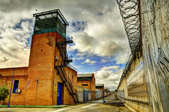 HDR Prison, tower and barbed wire. HDR Prison and barbed wire, cloudy day after storm Stock Photos