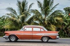 HDR red brown vintage car in Santa Clara Cuba Royalty Free Stock Image