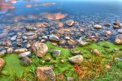 HDR of River edge rocks Stock Image