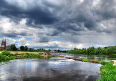 HDR of river landscape with storm clouds (sky) Royalty Free Stock Image