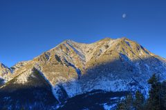 HDR Rocky Mountain with moon Royalty Free Stock Photography