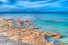 Hdr seashore with motion blur Royalty Free Stock Images