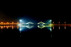 HDR of Sheikh Isa Bin Salman causeway Bridge and reflection on water Royalty Free Stock Photography