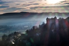 Winter sunset in east France castle countryside, Belvoir. HDR shot of Belvoir castle, background landscape nfog in the valley and clouds in the sky Royalty Free Stock Image