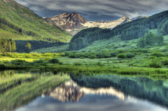 HDR Snow capped mountains and reflections Royalty Free Stock Photo