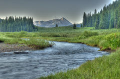 HDR. Streams and snow-capped mountains Royalty Free Stock Photos