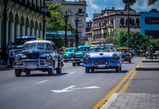 HDR - Street life scene in Havana Cuba with american vintage cars - Serie Cuba Reportage.  Stock Images