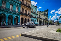 HDR - Street life scene in Havana Cuba with american vintage cars on the street - Serie Cuba Reportage.  Royalty Free Stock Image
