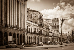 HDR - Street scenery with American vintage cars on the main street in Havana City Cuba - Retro Royalty Free Stock Images