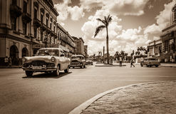 HDR - Street scenery with drived american vintage cars on the main street in Havana City Cuba - Royalty Free Stock Photo