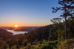 HDR Sunrise Over the Mountains beside a towering Pine. Sunrise Over a lake in the the Mountains beside a towering Pine HDR Stock Images