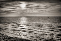 HDR Sunset in B/W. A high dynamic range beach picture near sunset, converted to black and white Royalty Free Stock Images