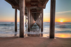 HDR Sunset behind the Huntington Beach pier Stock Photo