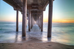 HDR Sunset behind the Huntington Beach pier Royalty Free Stock Photos