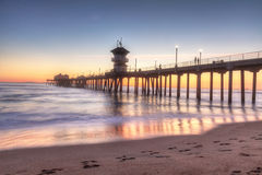 HDR Sunset behind the Huntington Beach pier Royalty Free Stock Images