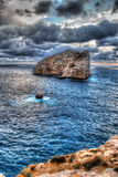 Hdr sunset. Sunset in Capo Caccia in hdr tone mapped Royalty Free Stock Image