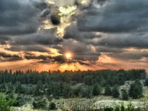 HDR Sunset over forest Royalty Free Stock Photography