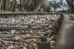 HDR tracks. HDR, day, outdoors, leaves, trees, tracks, wood, leafs, autumn, rusted, stones, screws Royalty Free Stock Image