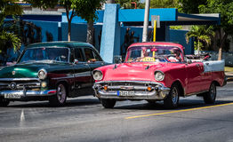 HDR two beautiful vinatge cars on the street in Varadero taxi in Cuba Royalty Free Stock Images