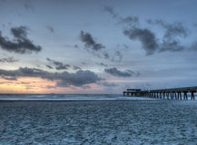 HDR of Tybee Island. With Clouds and Pier in Georgia Royalty Free Stock Photography