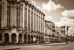 HDR - Urban street scenery in Havana City with american vintage cars on the main street in Cuba - Retro Serie SEPIA Cuba Reportage Stock Images