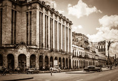 HDR - Urban street scenery in Havana City with american vintage cars on the main street in Cuba Stock Photo