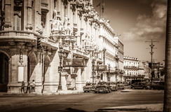 HDR - Urban street scenery in Havana City with american vintage cars on the main street in Cuba Stock Images