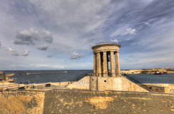 HDR View on the bell tower of Siege Bell Memorial in Valletta, Malta Stock Photography