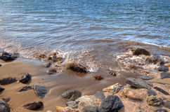 HDR view of waves over rocks Stock Images