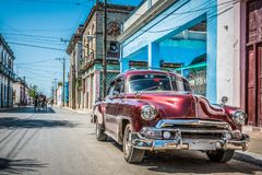 Free HDR - Wine Red American Vintage Car Parked On The Street In Havana Cuba Royalty Free Stock Photo - 111954675