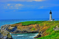 HDR Yaquina Head Lighthouse under blue skies Stock Photos