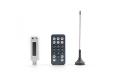 HDTV USB. Isolated HDTV USB with antenna and remote control royalty free stock photography
