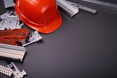 Hełm, rękawiczki i materiał budowlany, Obraz Royalty Free