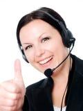hełmofon pokazywać uśmiechniętej kobiety kobieta s Zdjęcia Royalty Free