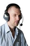 hełmofony odizolowywający mężczyzna Zdjęcie Royalty Free