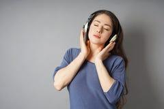 hełmofony target1167_1_ muzykę kobiety potomstwa obrazy royalty free