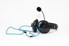 Hełmofony z mikrofonu i drutu dźwigarką odizolowywającą na białym bac Obraz Stock