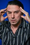 Head ache. This picture represents a middle age man showing signs of a head ache or migraine Stock Photo