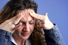 Head ache expression. Head ache pains on a blue background royalty free stock photo