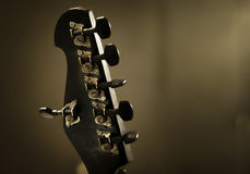 Head from an acoustic guitar with tuning gears Stock Photo