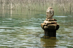 Head of ancient Buddha in  big lake . Stock Photography