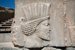 Head of ancient warrior on the destroyed stone bas-relief Royalty Free Stock Photos